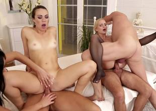 Two brunette hair women and a blonde are fucking in an orgy