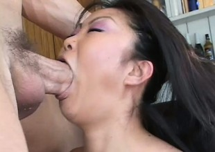 Lucy Lee lubes her poop chute up abundantly and takes a fat one into it