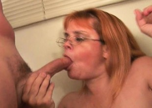 Plump grandma with glasses takes a pounding from a couple of cocks