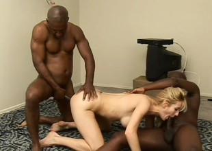 Large breasted blond cougar has 2 black studs sharing her tight pussy