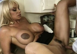 In the kitchen, buxom blonde mom Kat Kleevage sucks and copulates a juvenile stud's big rod
