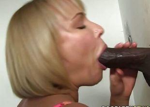 Glory hole blonde sucks black cock