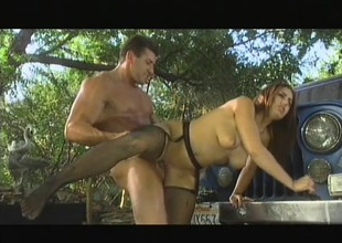 Melanie Jagger acquires it on on top of a car eating dong and getting arse drilled