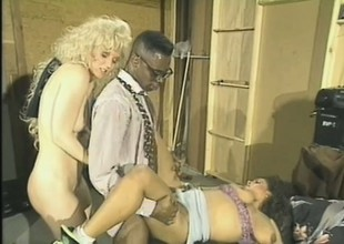 Old school movie of a pair of white bitches taking a big dark dick