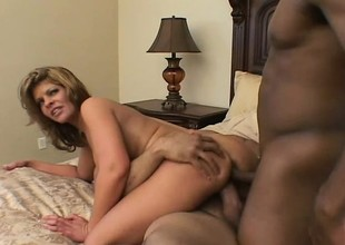 Luscious Latina with big tits has 2 dark guys sharing her moist holes on the bed