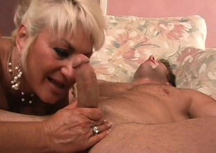 Stacked mature blond is on the prowl for a young stud with a big cock