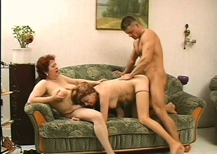 2 naughty mature ladies seduce a young stud and he takes care of their sexual needs