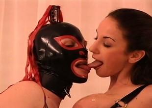 Masked lesbian is licking the hard pink teats of amusing ass peddler