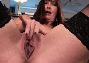 The hawt brunette massages her tits and fingers her tight little pussy
