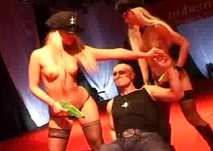 Two blonde strippers on stage get fucked by a large hard 10-Pounder