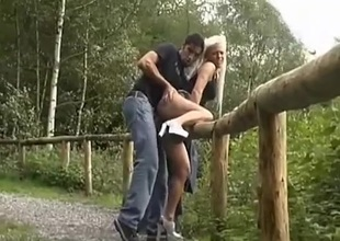 Pair fucks outdoors with a view of the river