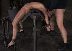 Flexible girl bent over backwards and face fucked