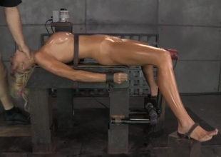 Slave girl coated in oil and fucked down the throat