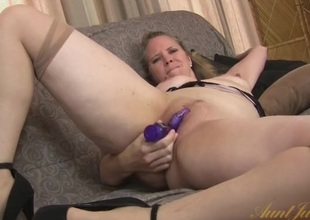 Big ass mommy fucks a dildo into her slit