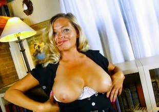 Non-professional blonde milf chats and plays with her tits