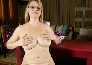 Chatty naked mommy fondles her big tits gently