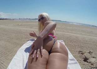 Curvy sweetheart Blondie Fesser with oiled up bubble butt removes her bikini thong and gets her rectal hole fingered from behind right in the sun. She shows her assets in the middle of somewhere