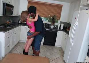 Petite ivory girl Natasha White in pink brassiere and hot shorts drops on her knees in the middle of the kitchen and acquires her mouth filled with black monster cock. He stretches her mouth to the max with his large pole