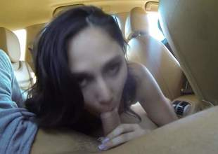 Nice brunette girl with titties out wraps her sexy lips around men hard dick in a car. Then bad girl spreads her legs. She makes men sex fantasies come to life in the backseat