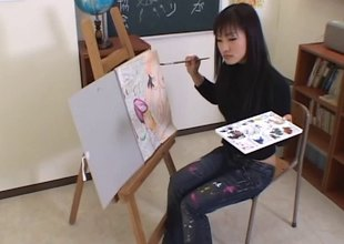 Artistic Asian girl paints his body then gives him a head