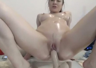 Huge tittied floozy rides her suction cup dildo like a bitch possessed