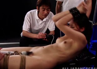 Rope fastened Asian girl cums from plenty of vibrator play