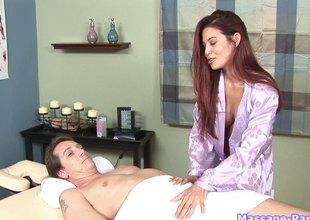 Redheaded massage babe gives his rod a great blowjob