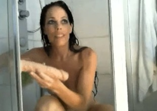 Luxurious dark brown amateur wife films herself masturbating