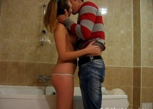 Charming teen in a thong sneaks her boyfriend to the bathroom for a hardcore pussy drilling session