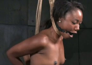 Ebon porn slut Chanell Heart is tied up and stretched in porn episode