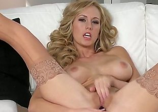 Brett Rossi with soaked breasts and shaved slit spends time rubbing her muff