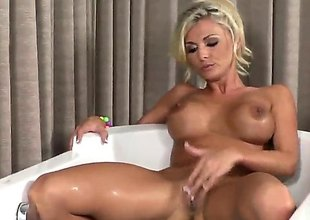 Charming porn diva Alicia Secrets with massive melons and shaved beaver fills the hole between her legs with sex toy for web camera in solo action