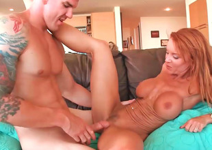 Sexy milf Janet is a horny redhead who can't live without cocks