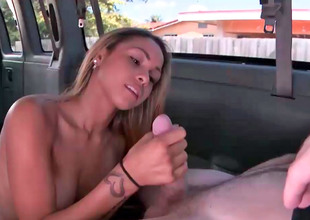 Tanned blonde is having casual sex in a huge van