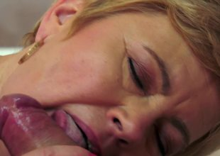 A fat old woman receives a big dick in her mouth and in her love tunnel