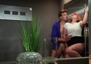 A sexy slut with red hair is having her body groped and touched