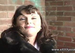 Unwilling milf is finally persuaded to show off outside