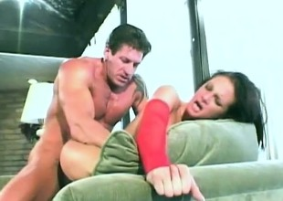 Delightful dark brown with big tits takes a long shaft up her tight gazoo