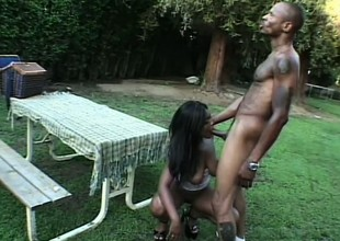 Busty caramel girl Shawna passionately bounces on a huge black rod in the backyard