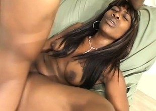 In a hotel room, ebony hottie with big tits Dior has a dark guy fucking her muff