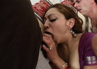 Indian bimbo gets herself pounded from both ends by white meat