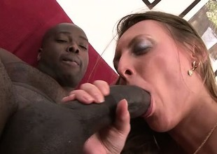 Cock starved white girl enjoys being fed by a stiff darksome dick