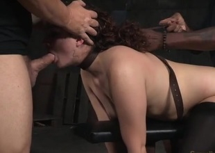 Curly hair beauty in bondage used by hard knobs
