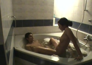 Teen pair filmed as they fool around in the bathtub
