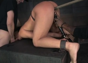 BDSM slave girl fucked from behind in the dungeon