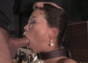 Fastened Asian drenched in spit as they face fuck her