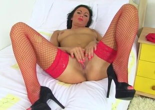 Hot lady in lipstick rubs her sexy pussy