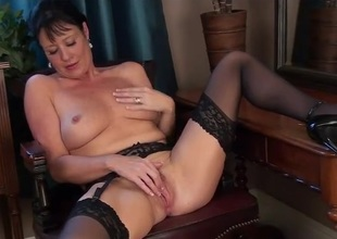 Classy milf beauty in black nylons rubs her sexy cunt