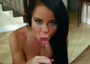 Dark haired beauty sucks and slobbers on his dick