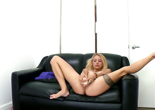 Miniature tits blonde is sucking a dildo